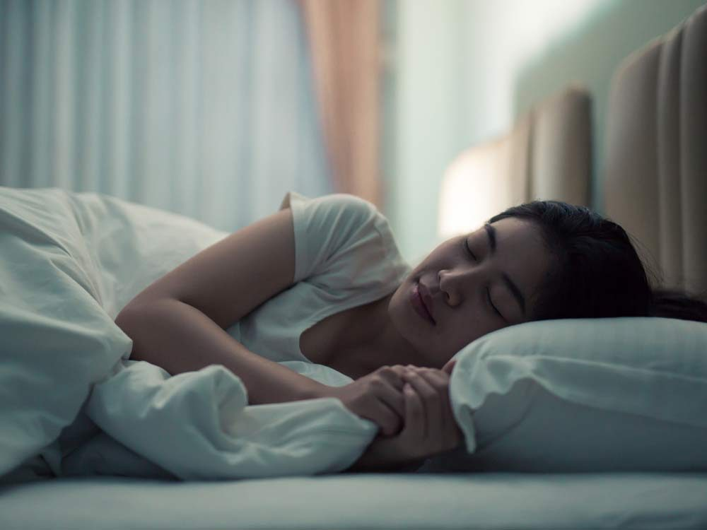 Young woman sleeping at night