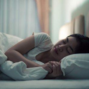 Young woman sleeping at night