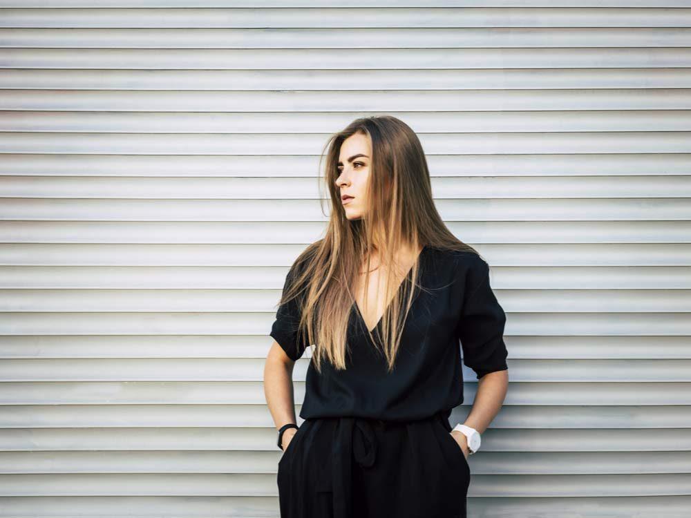 Woman wearing stylish black jumpsuit