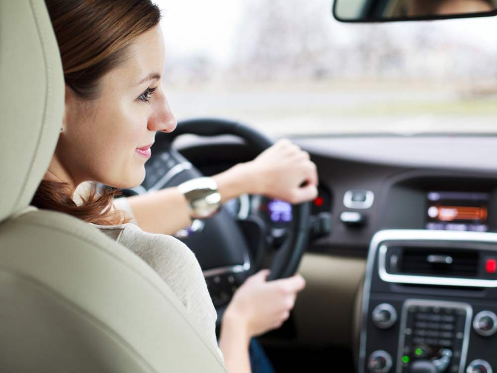 Woman driving vehicle