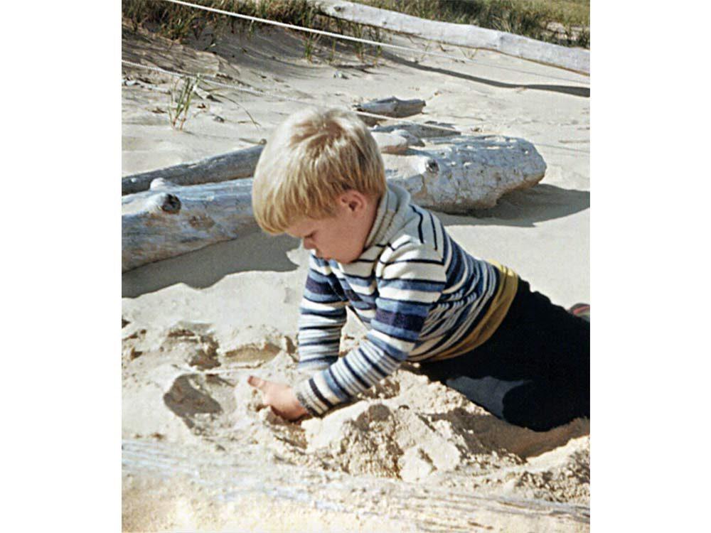Adam playing on the beach of Caribou Island