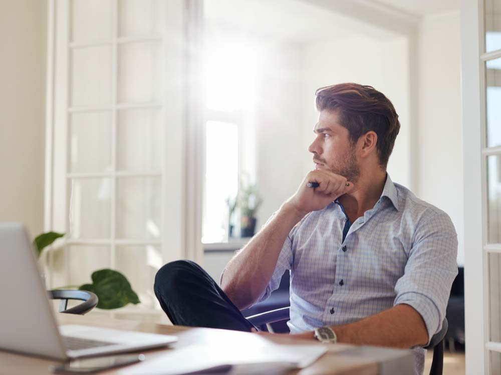 Man lost in thought at work