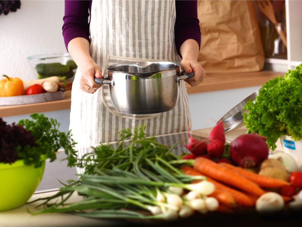 Woman preparing vegetables in kitchen