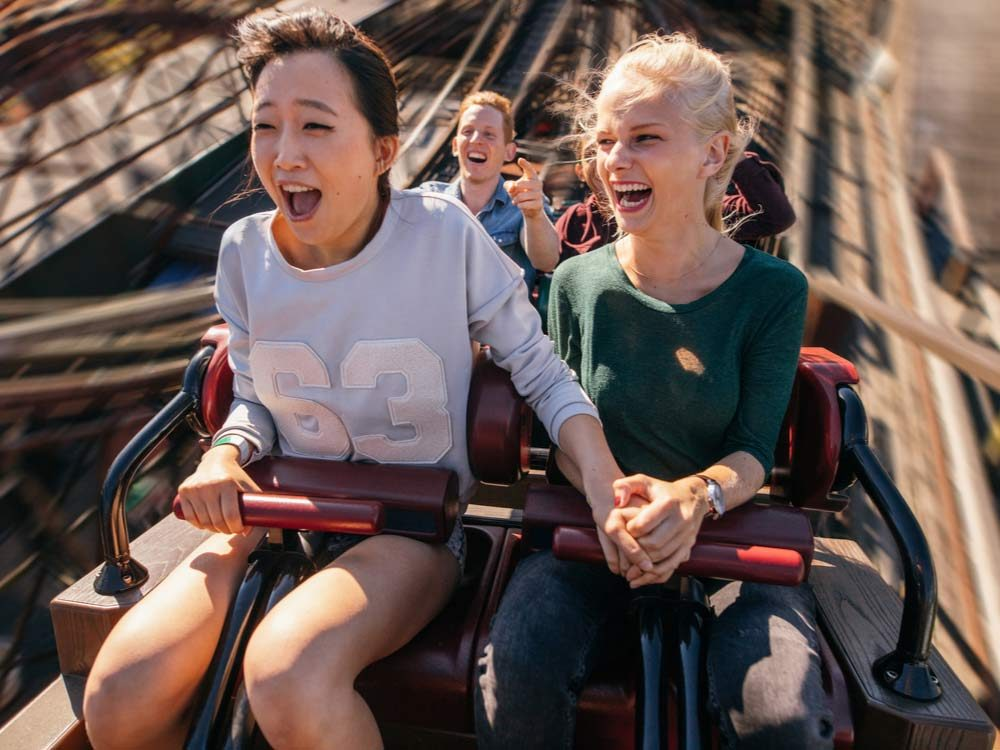 Couple on wild roller-coaster ride