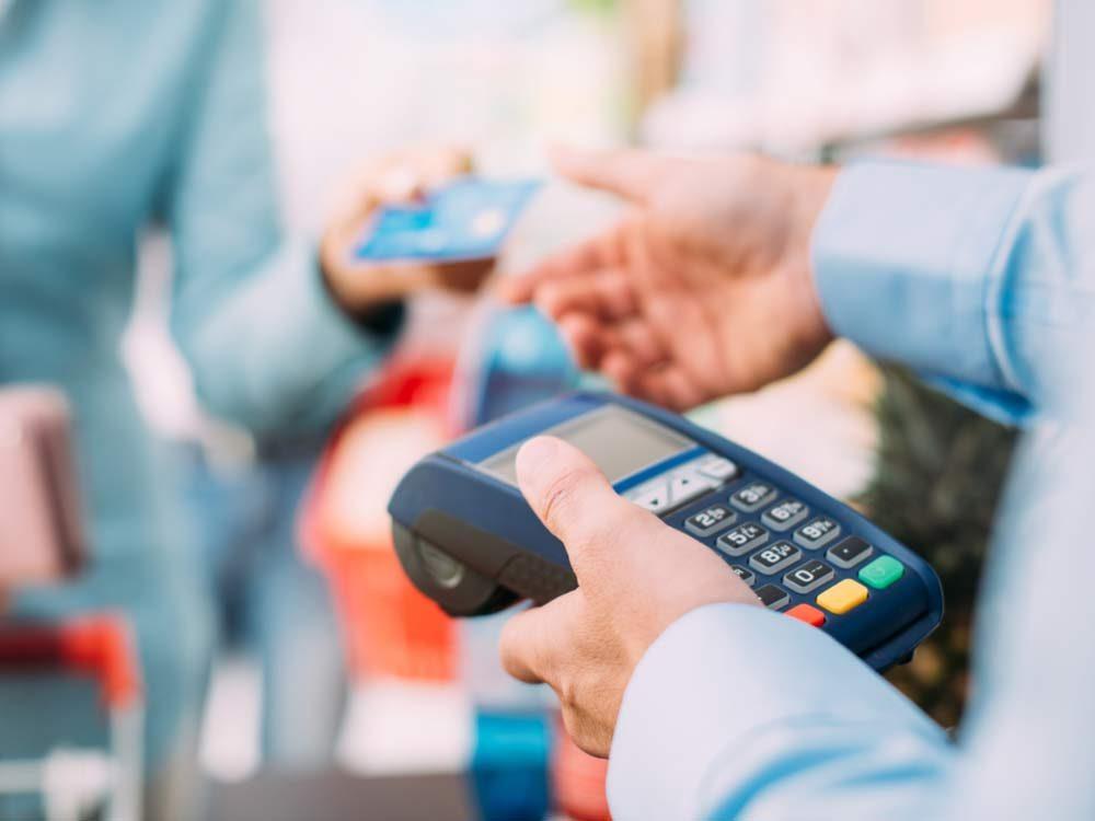 Cashier and customer at till