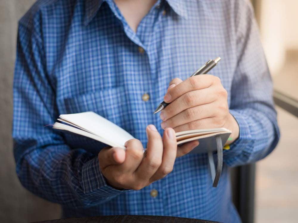 Man writing left-handed
