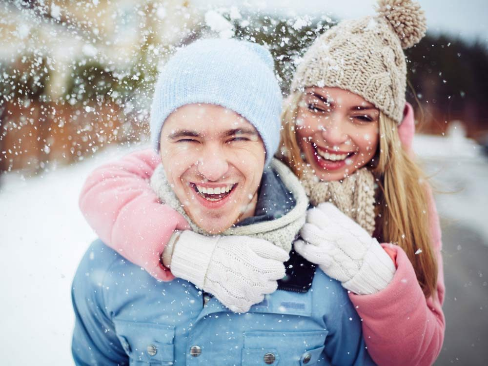 Couple enjoying snowfall