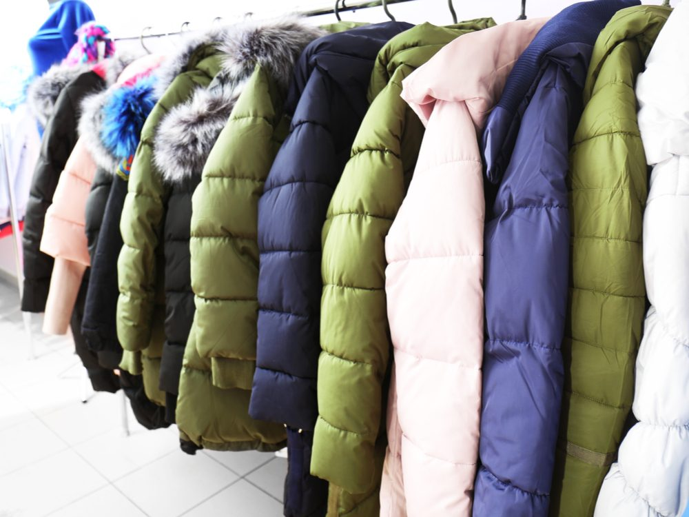 Winter parkas on rack