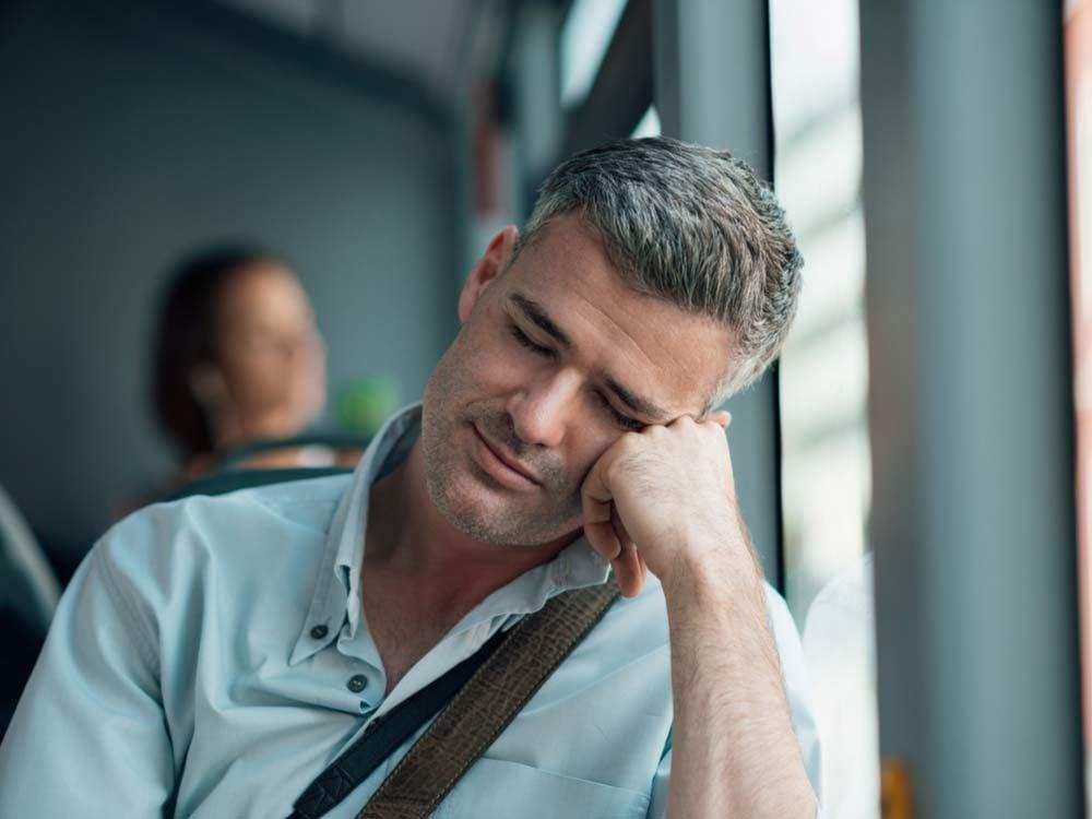 Man sleeping on his morning commute
