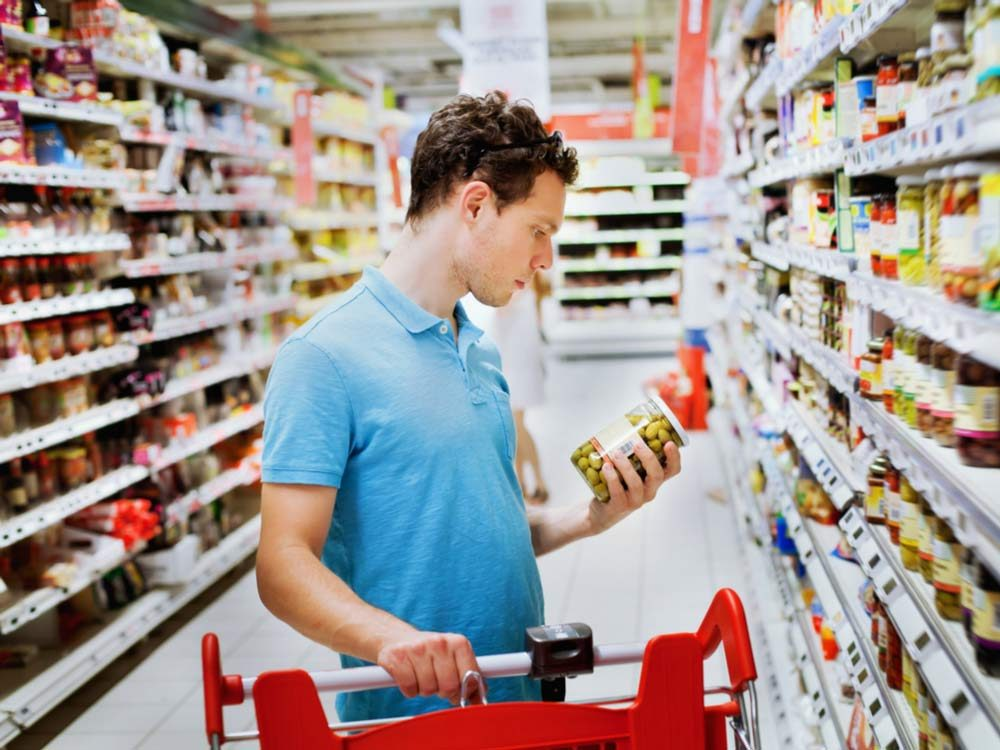 Man looking at produce in grocery store