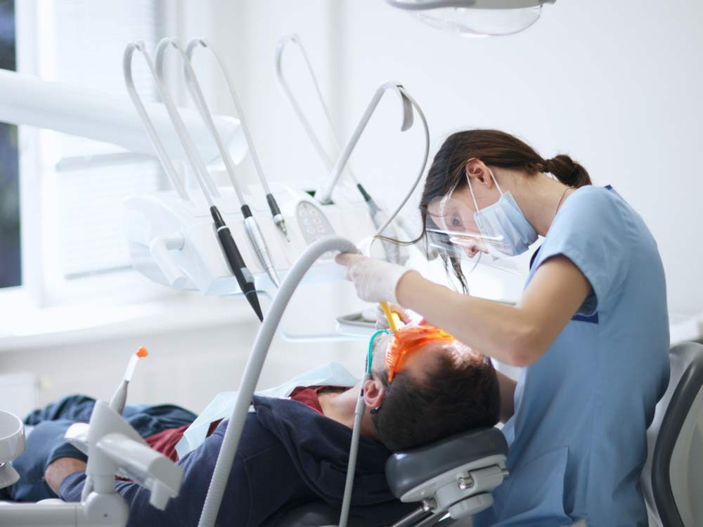 Dental hygienist with patient