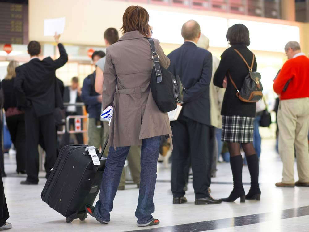 Travellers waiting at airport