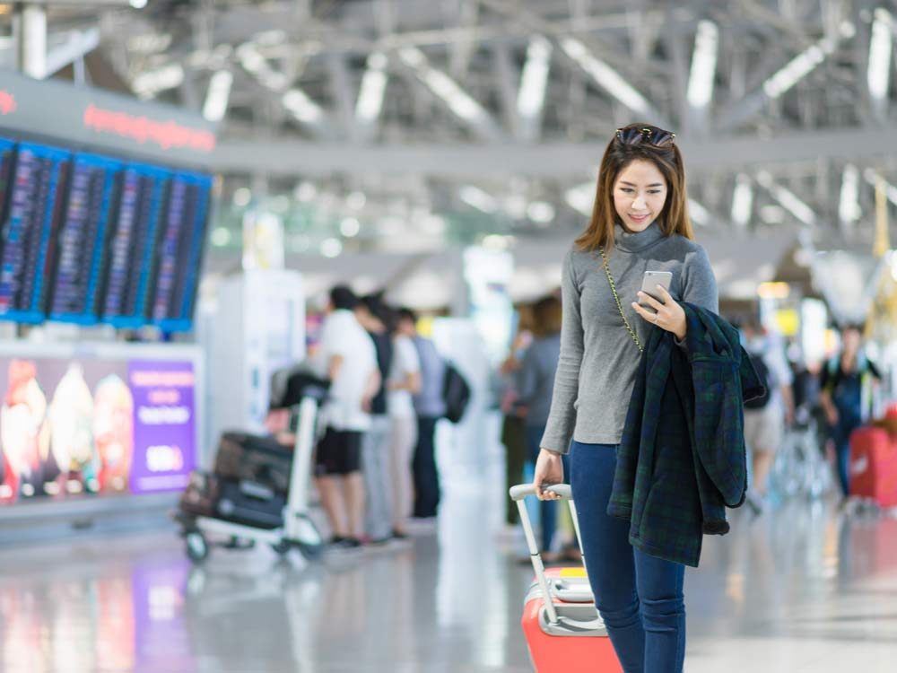 Charming businesswoman at airport