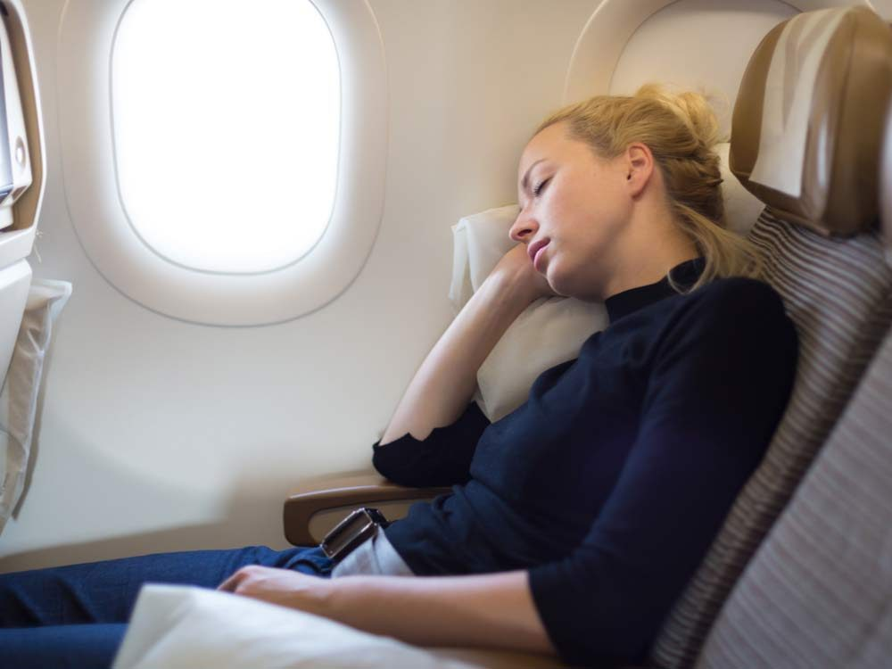 Woman sleeping on airplane