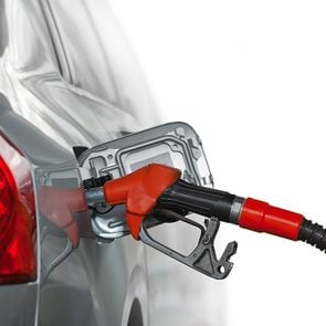 Why don't all cars have gas tanks on the same side?