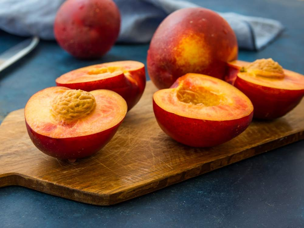 Nectarines on wooden cutting block