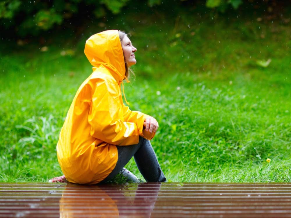 Woman in yellow raincoat