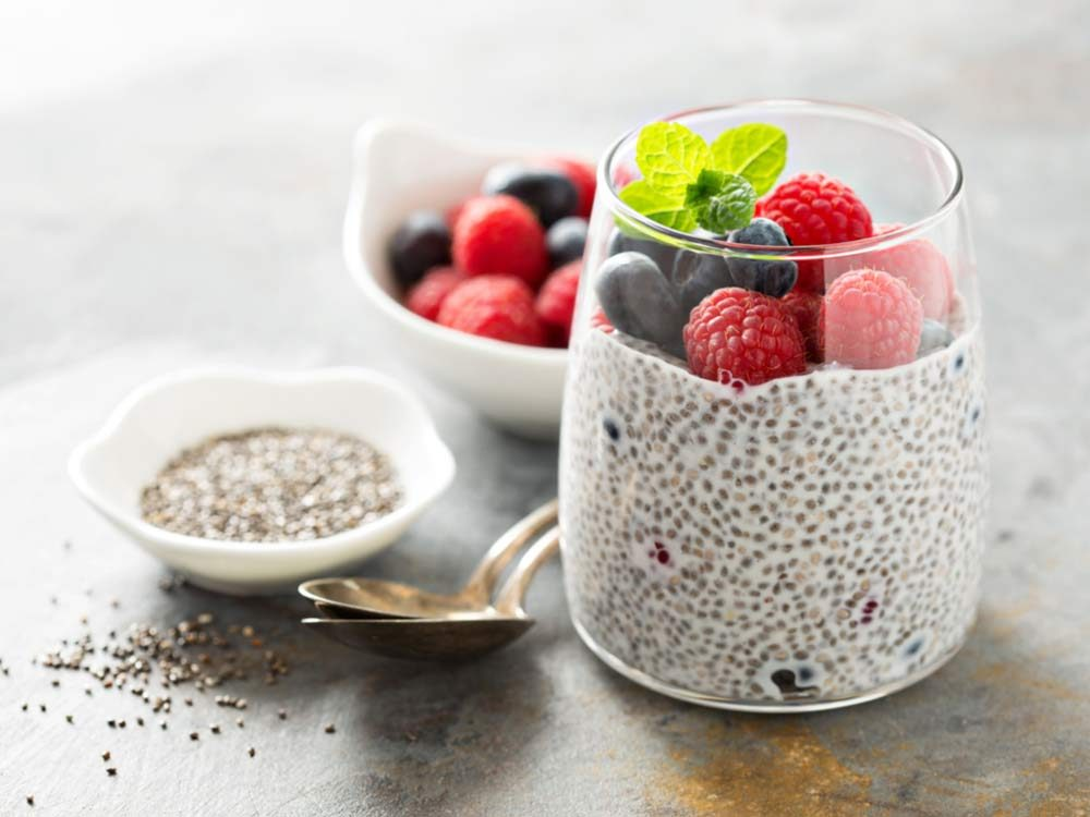 Healthy vanilla chia pudding in a glass with fresh berries