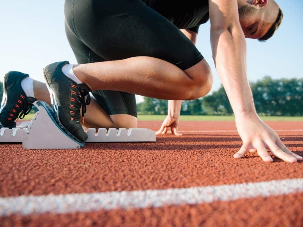 Runner preparing for race at starting block