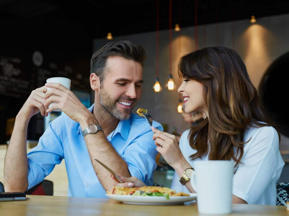 Couple eating salad at a cafe