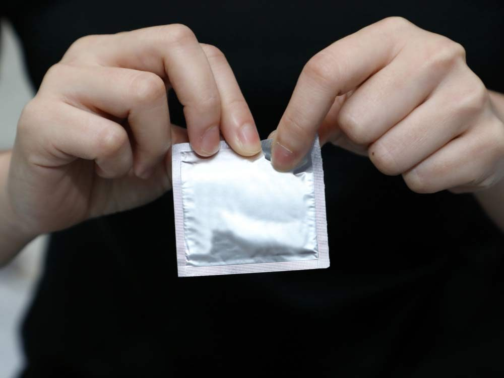 Woman holding a condom