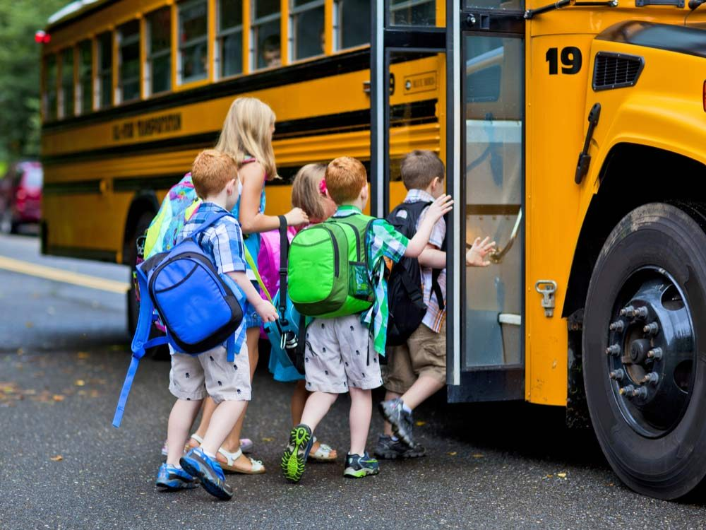 Children boarding yellow school bus