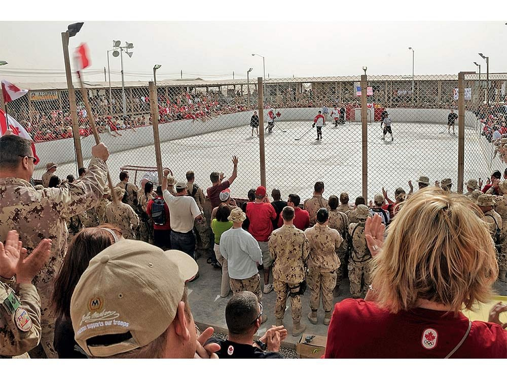 Canadian soldiers watching hockey game in Afghanistan