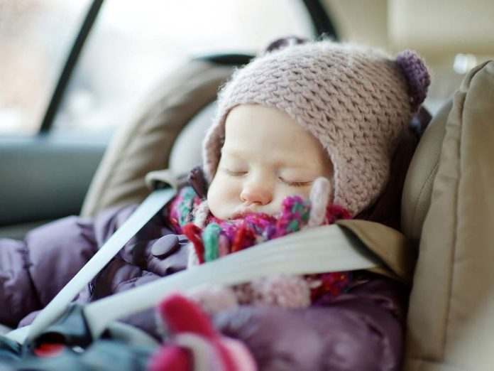 Baby in car seat during winter