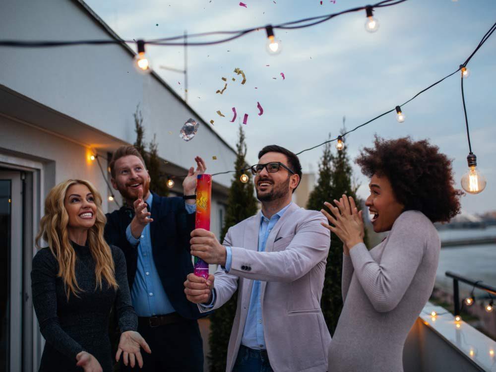 Four friends having a celebration