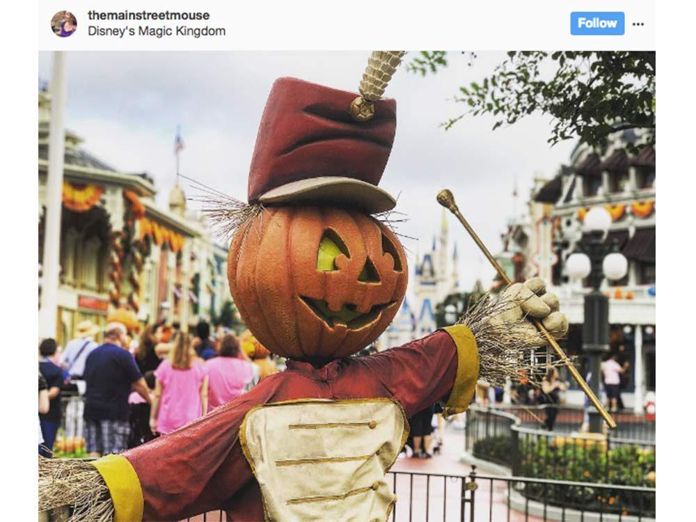 Halloween statue with pumpkin
