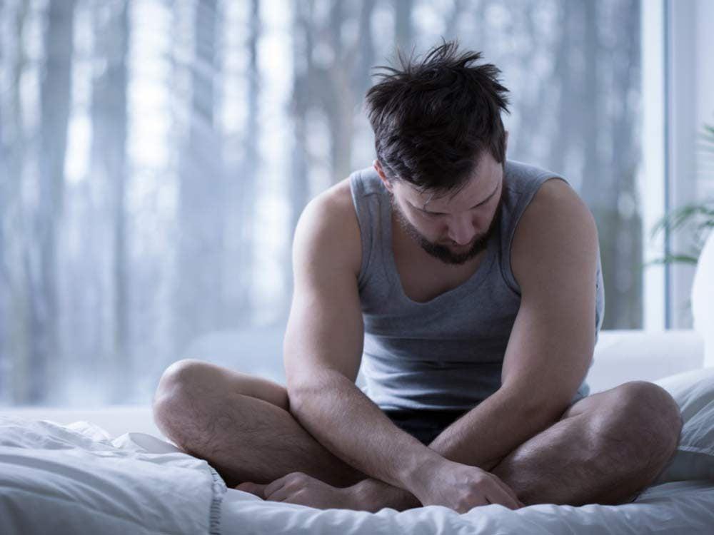 Depressed man waking up
