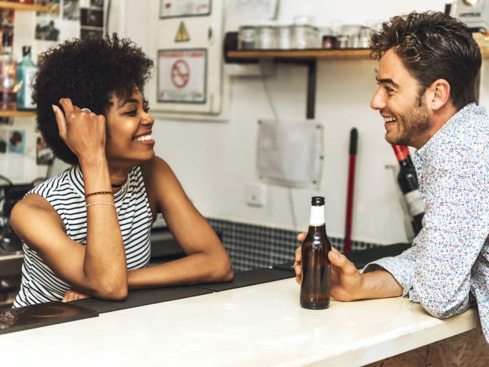 Man flirting with bartender