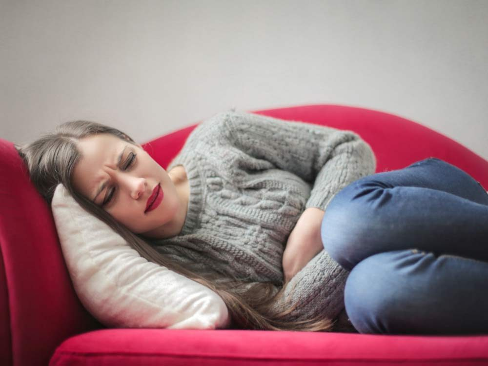 Woman experiencing stomach pains