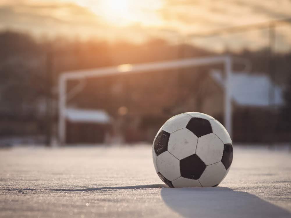 Soccer ball on field in winter