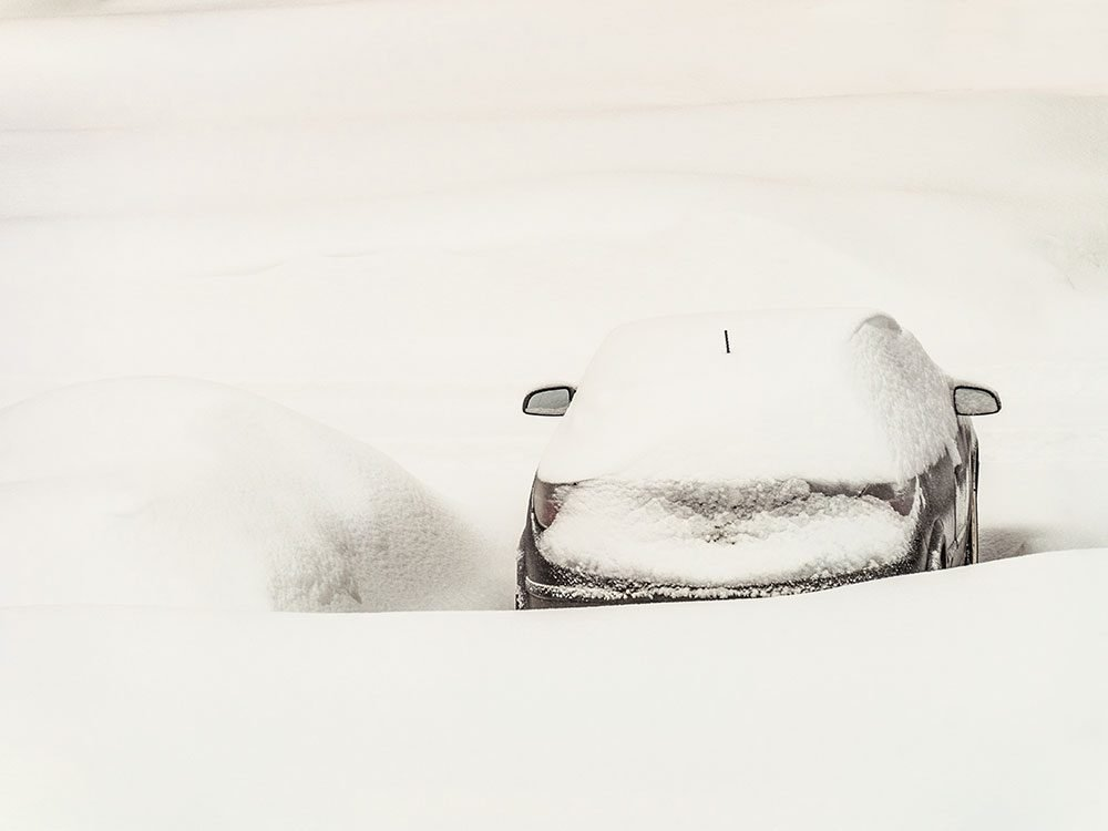 An abandoned car in a Manitoba snowstorm