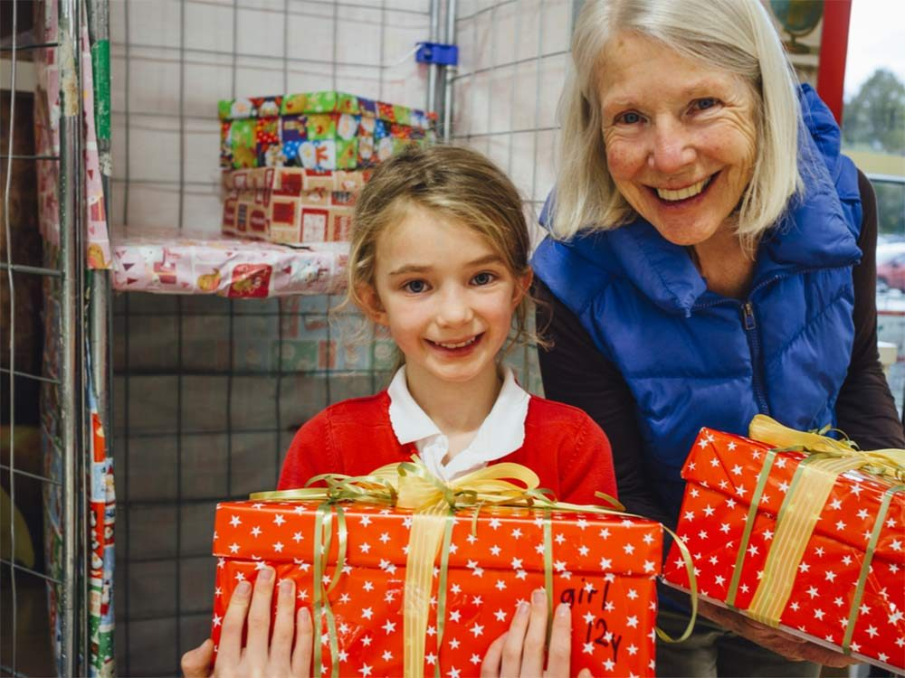 Grandmother and granddaughter at Christmas toy drive