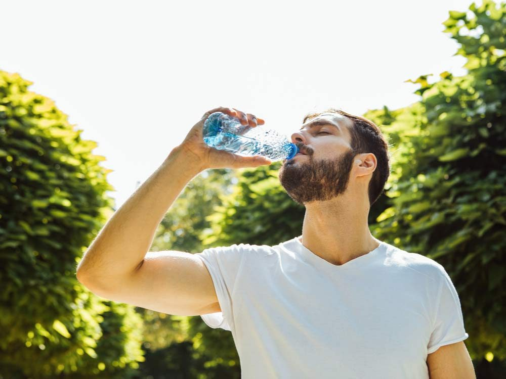 Bearded man drinking water