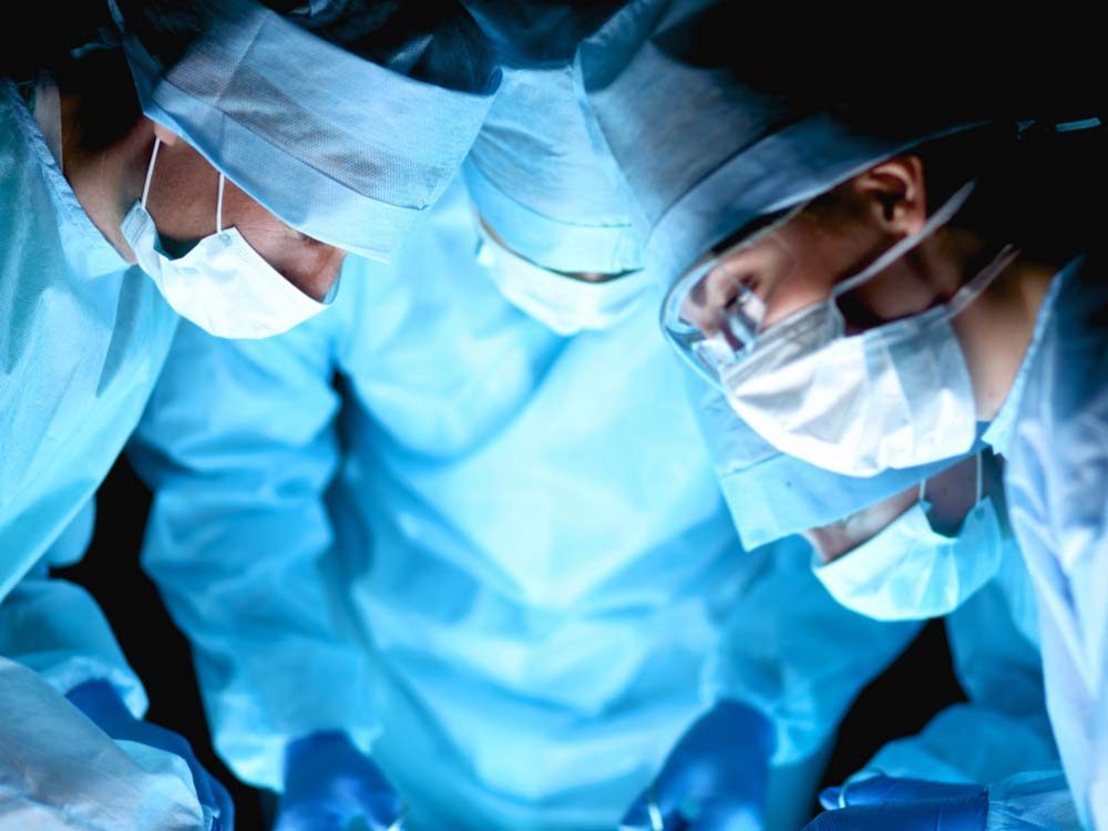 Doctors performing surgery procedure
