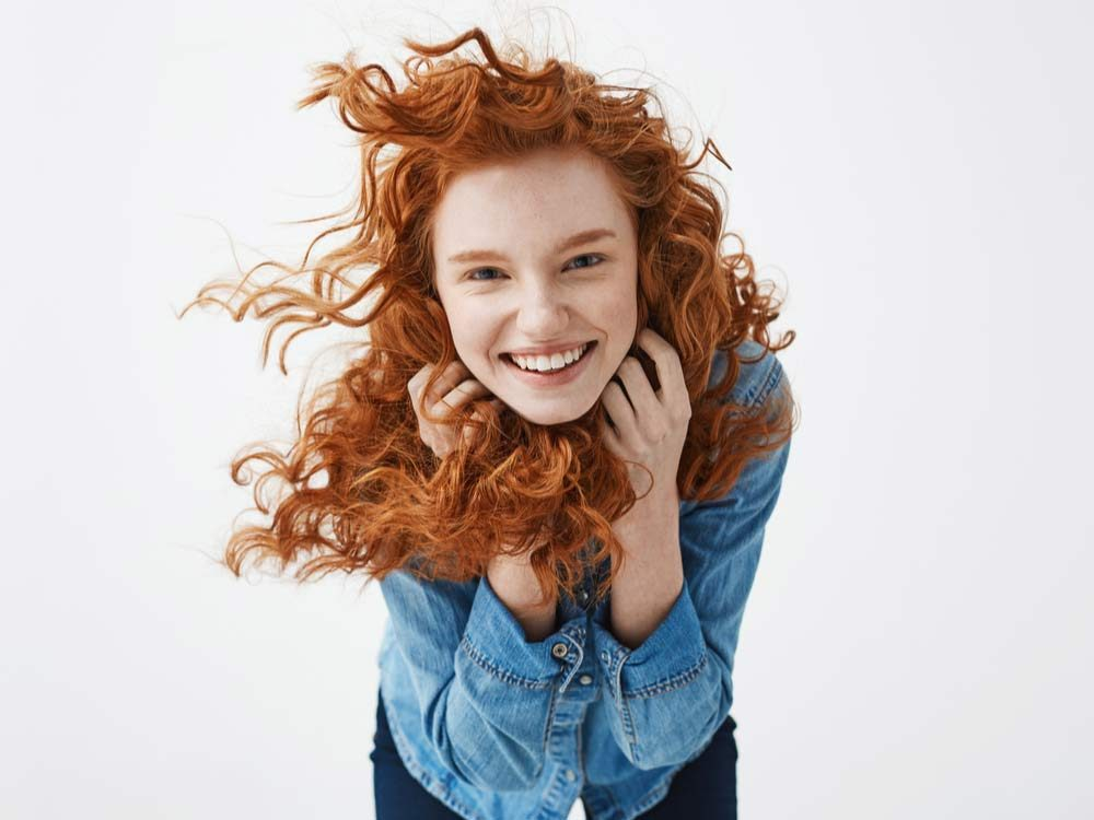 Smiling red haired woman