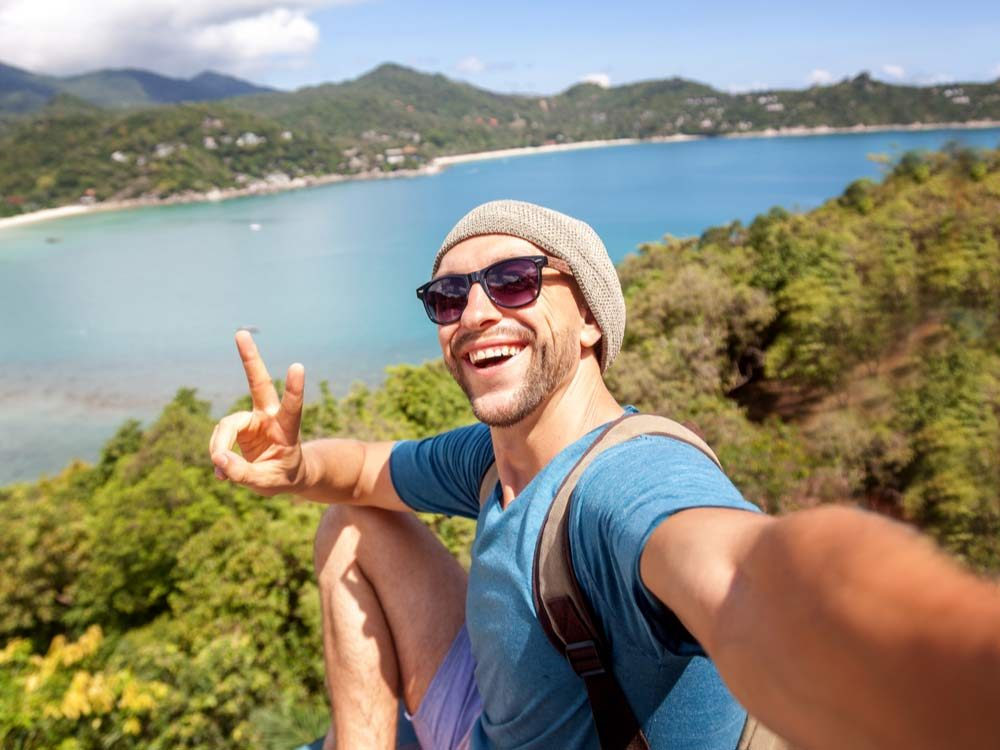 Man taking selfie in exotic locale