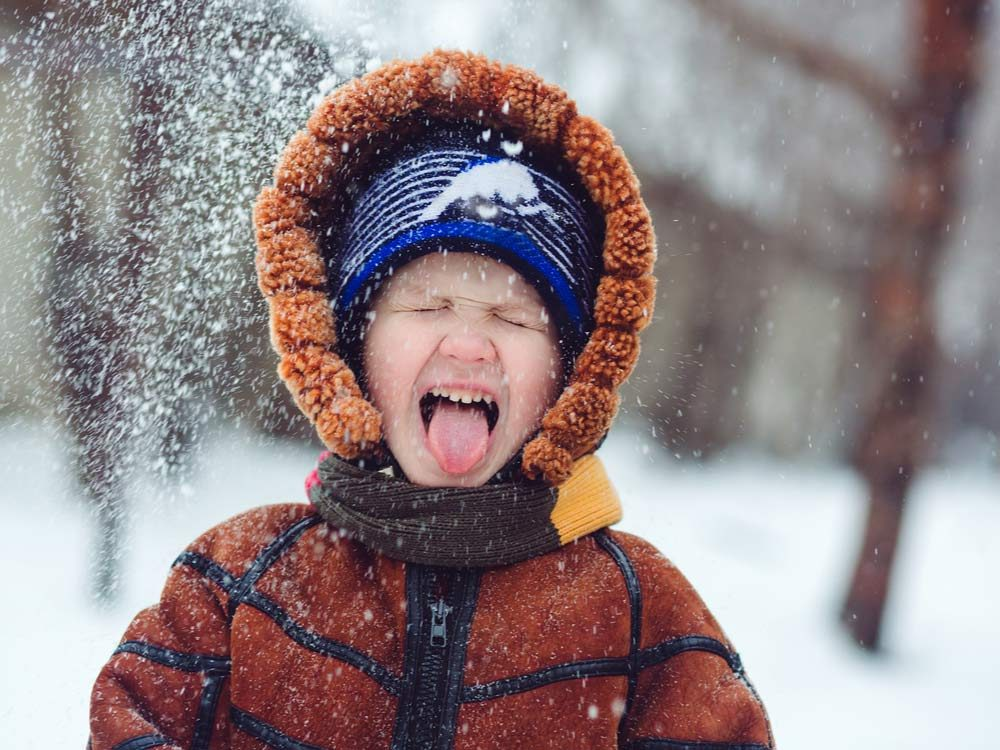 Young boy enjoying winter play