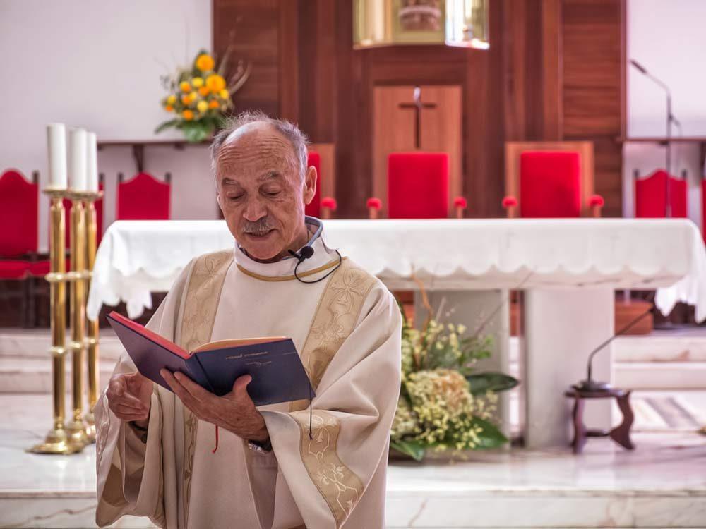 Priest giving sermon