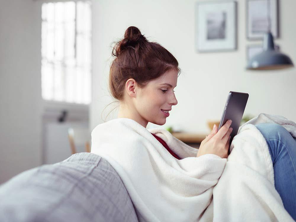 Woman under blankets