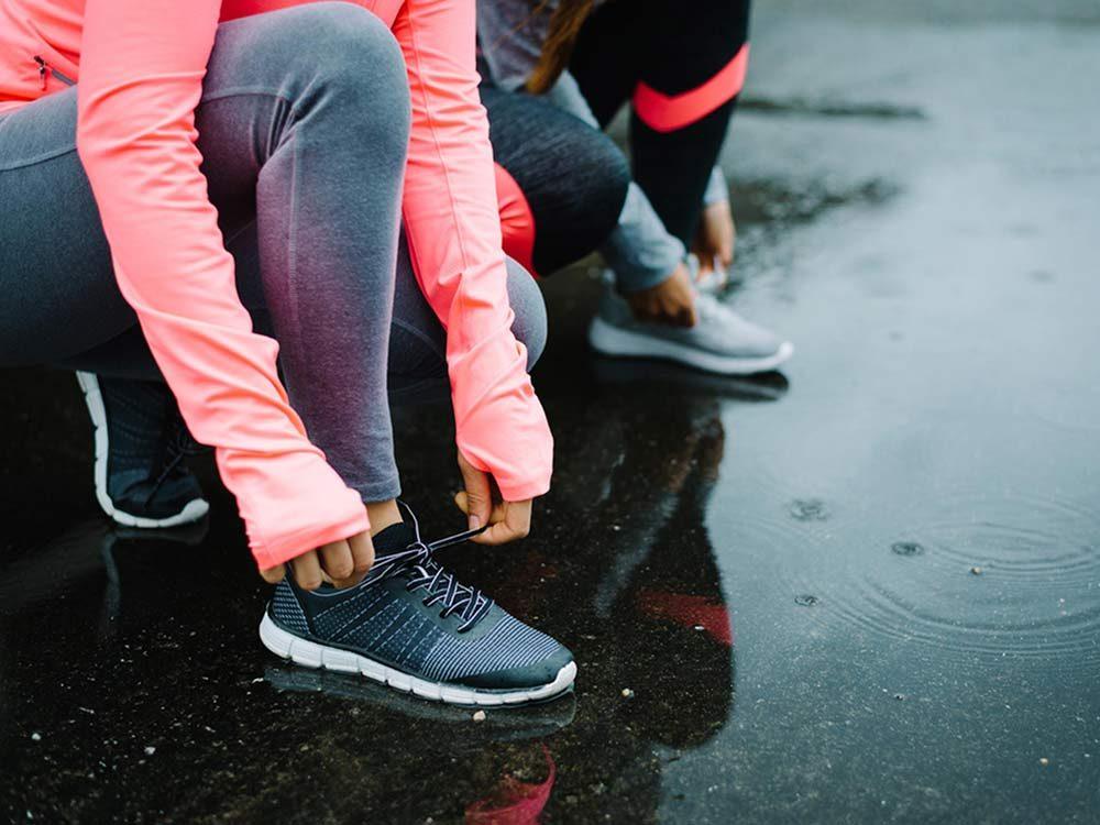 Tying running shoe
