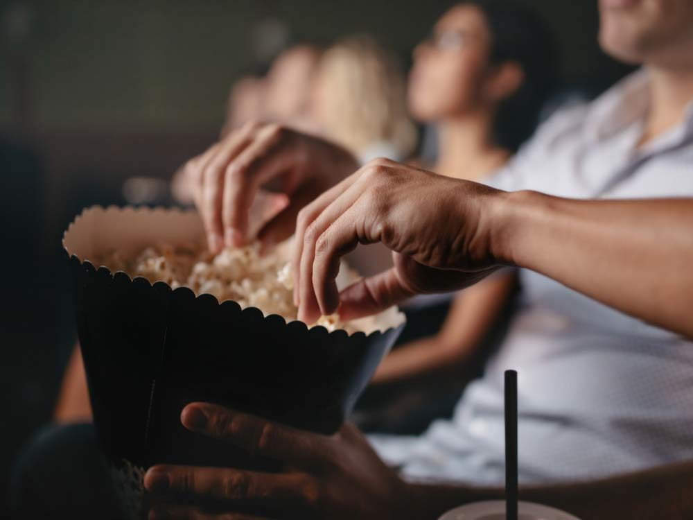 Sharing popcorn at movie theatres