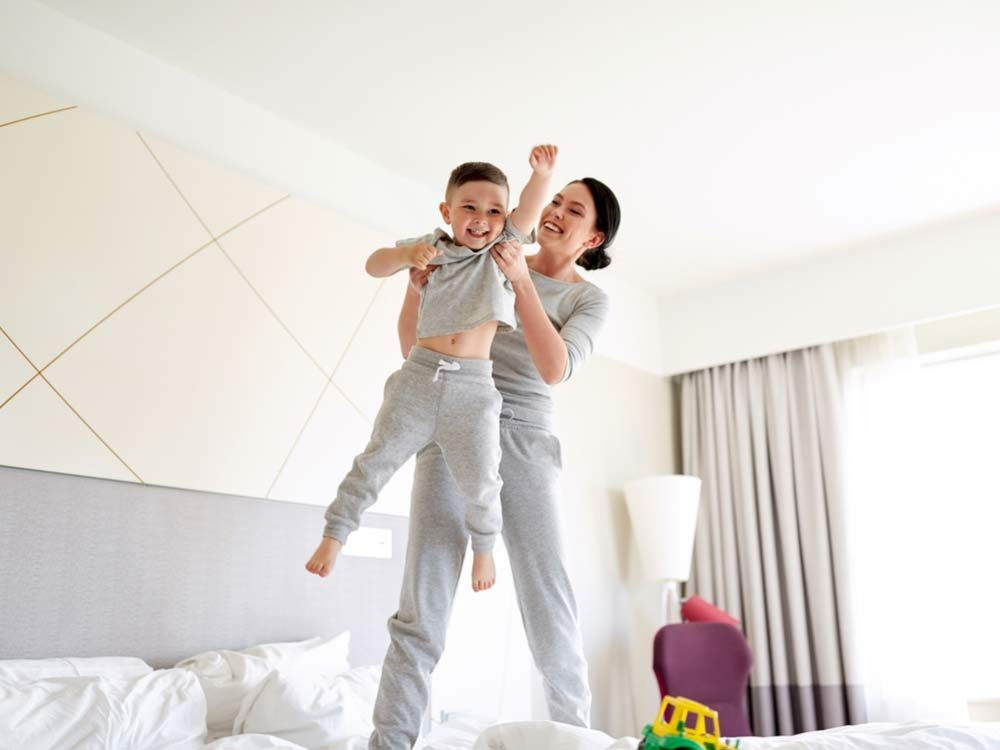 Mother and son in hotel