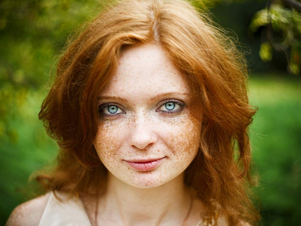 Woman with red hair and blue eye colour