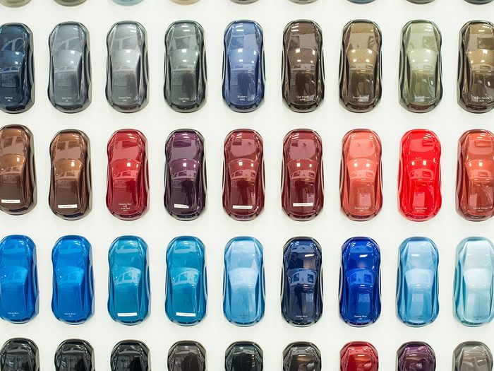 Red cars more accidents - Various car metallic paint samples on stand