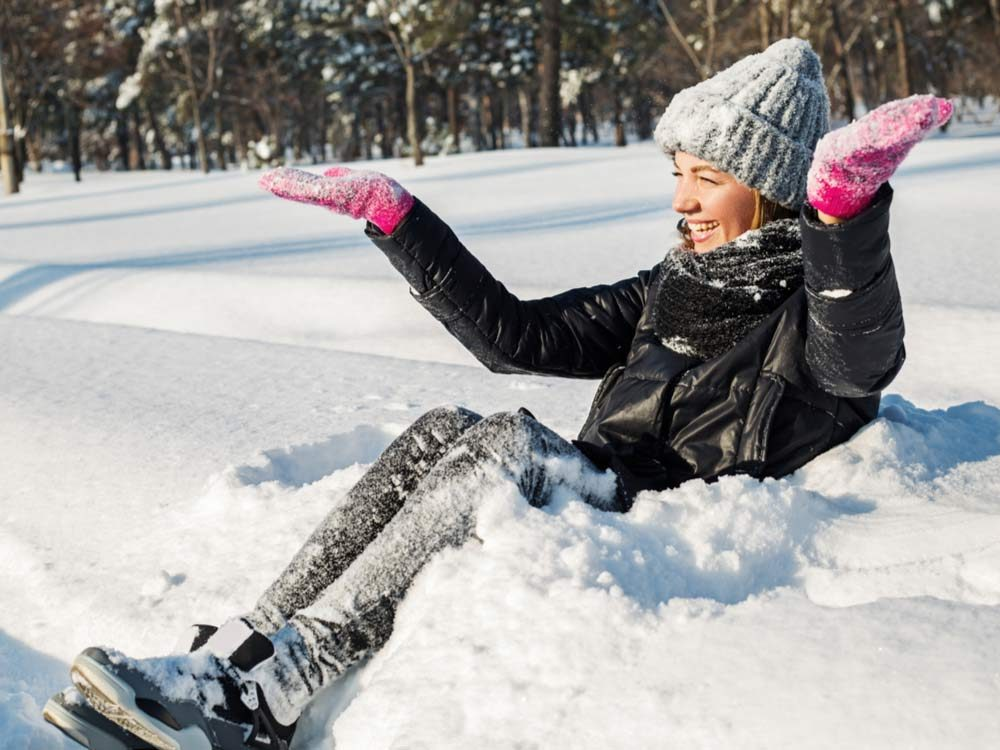 Woman enjoying snow in winter
