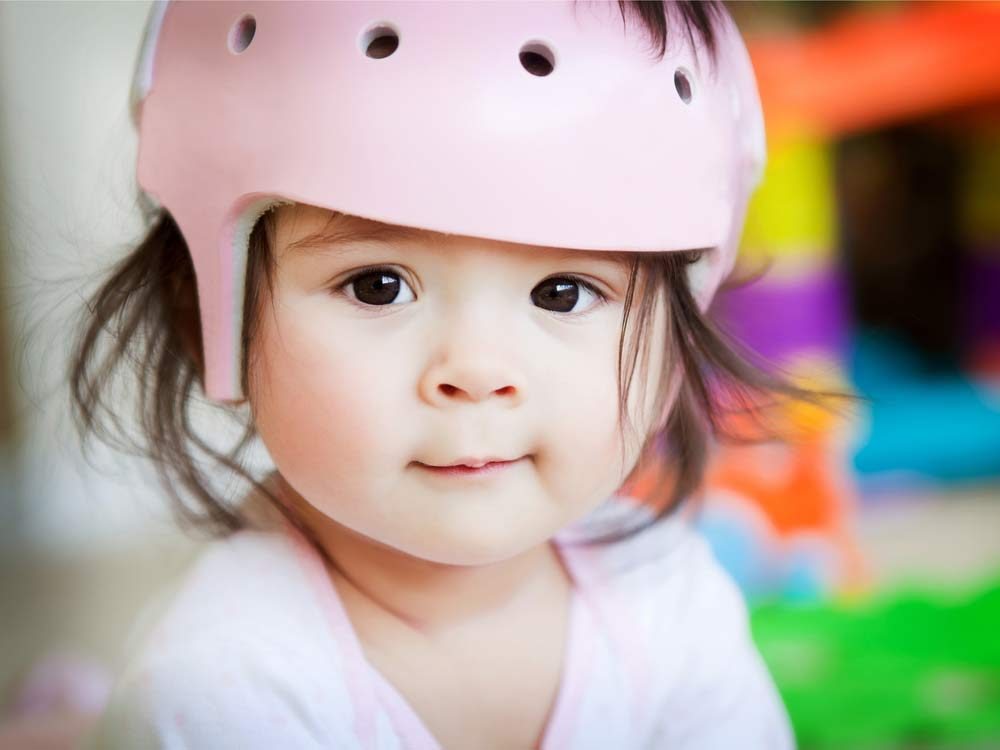 Cute baby wearing helmet